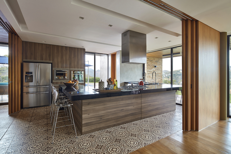 The floor tiles and all the wood and exposed brick give the kitchen a welcoming look and feel
