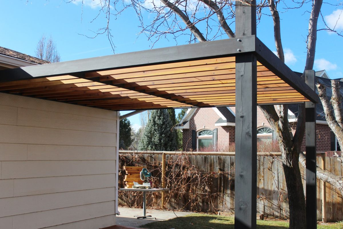 monotone wood pergola is beautiful in its own right as well