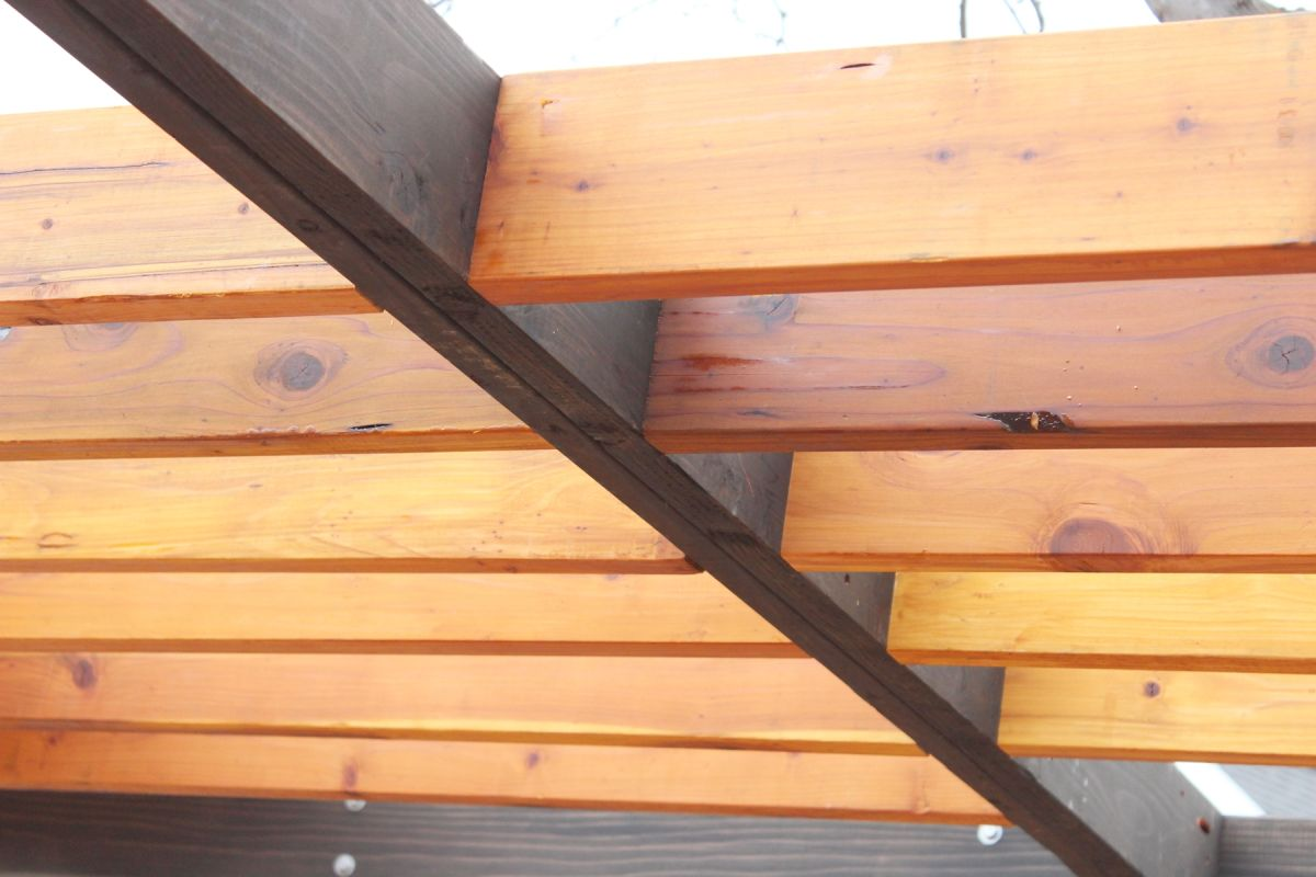 recommend that you install one or two rafters on one side of your center beam
