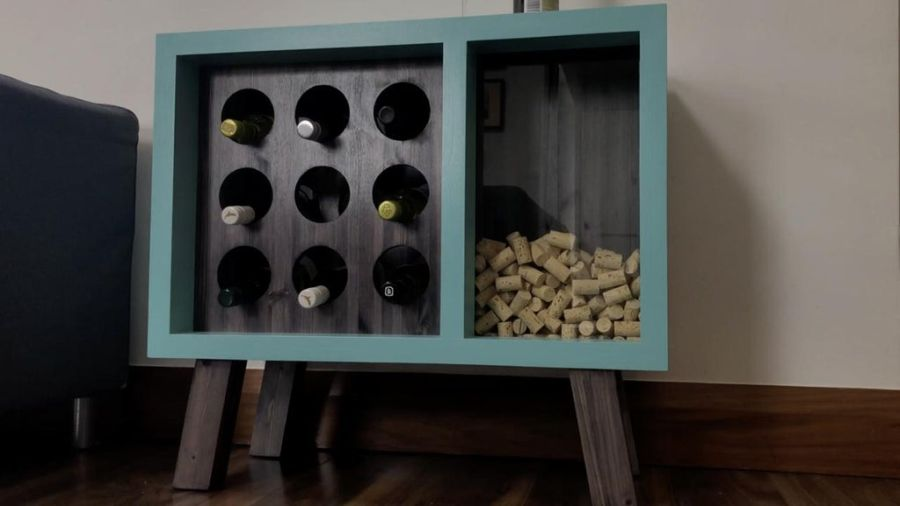 A stylish wine rack with an attached cork holder