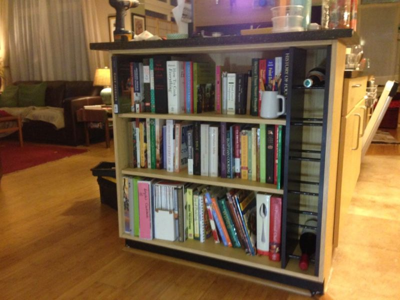 A wine rack built into a bookcase