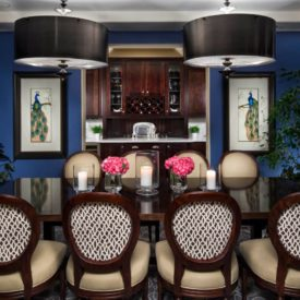 Add symmetry with peacok framed arts on dining area