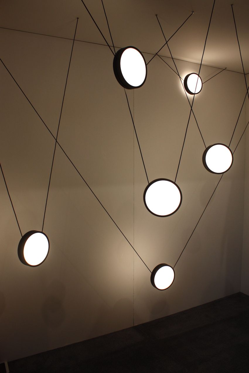An arrangement of suspended lights is an artful installation.