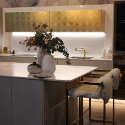 The golden cabinets are a glamorous touch that is not an over-the-top element.