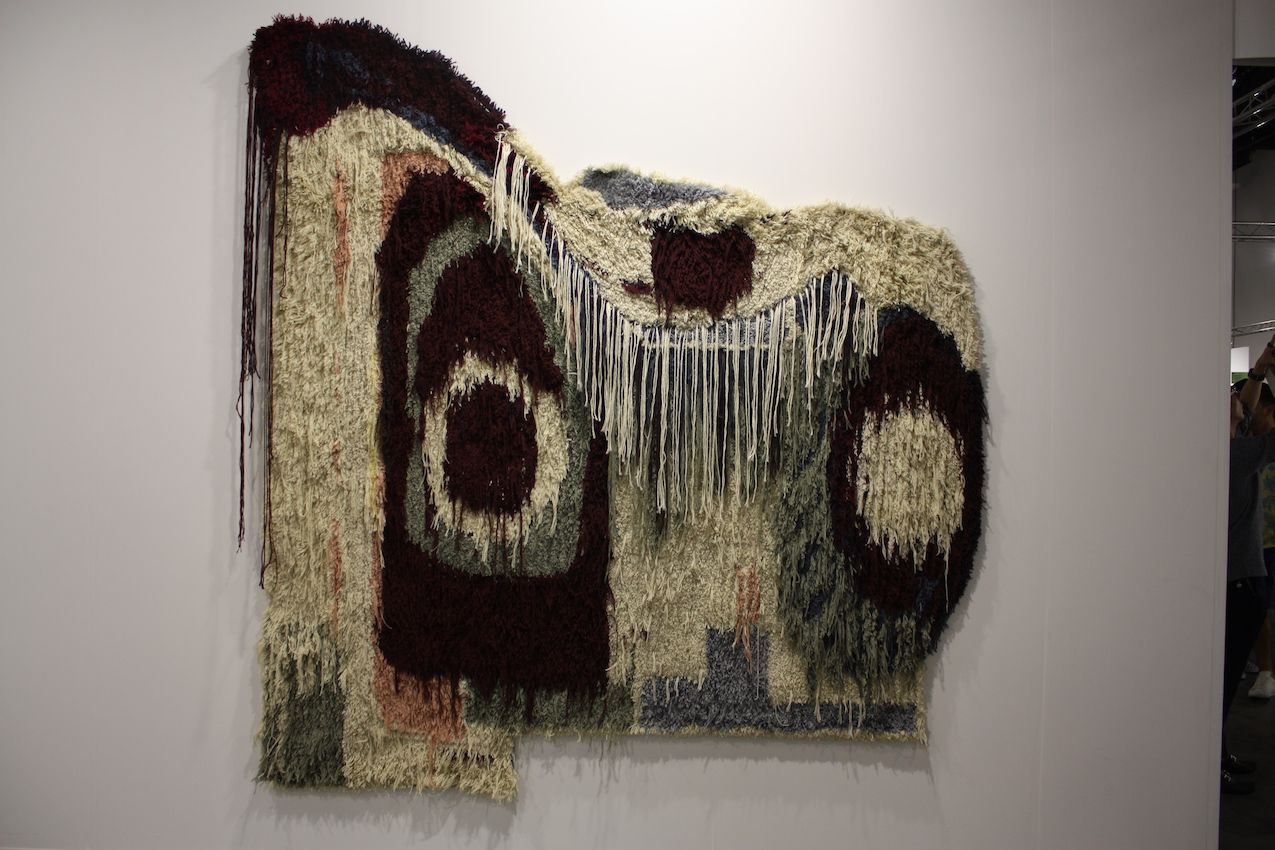 This artist's pieces include wool wall-hangings, drawings and paintings.