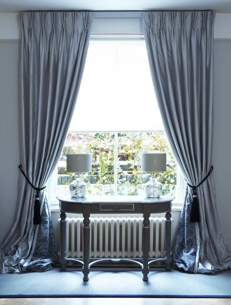 Properly hung, drapes look luxurious and full.