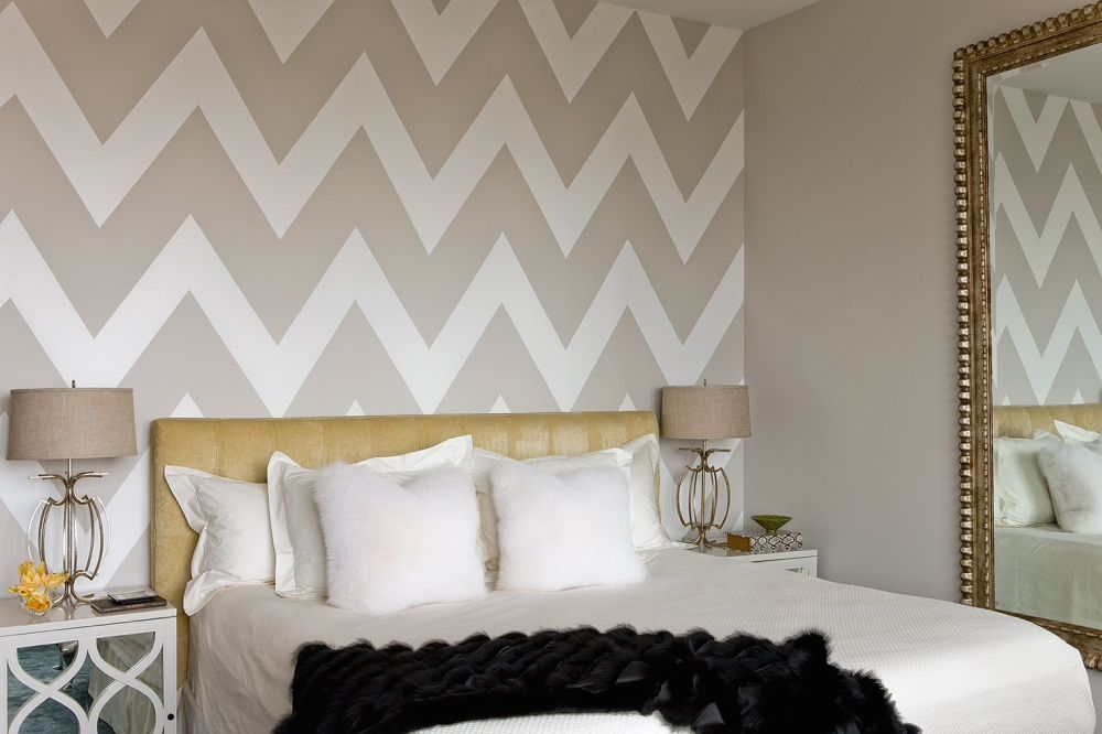 Contemporary bedroom with beige chevron