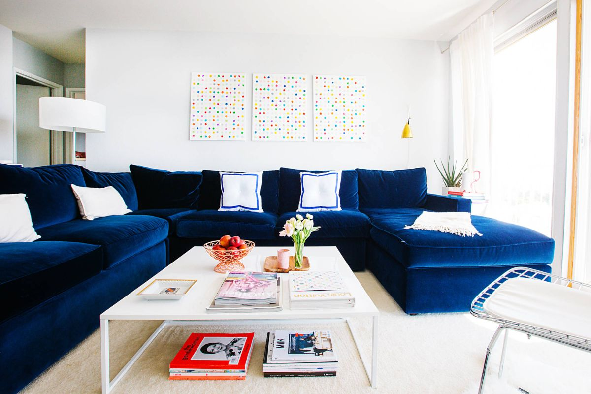 Contemporary living room with u shaped blue velvet sofa