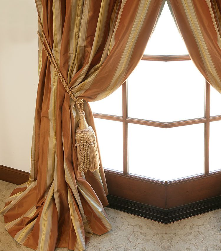 Curtain measurements should extend past the window on each side.
