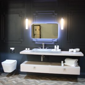 Mirrors with backlighting are becoming common in new bathroom designs.
