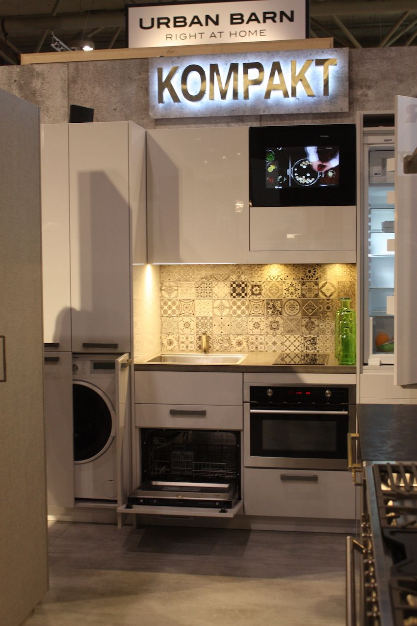 The KOMPAKT kitchen design can also incorporate a small television.