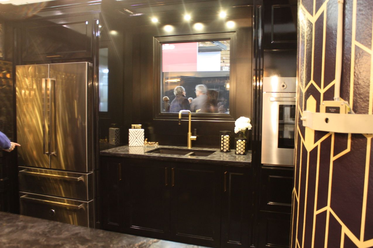 Dark wood and glittering metallic fixtures and accents make for a chic space.
