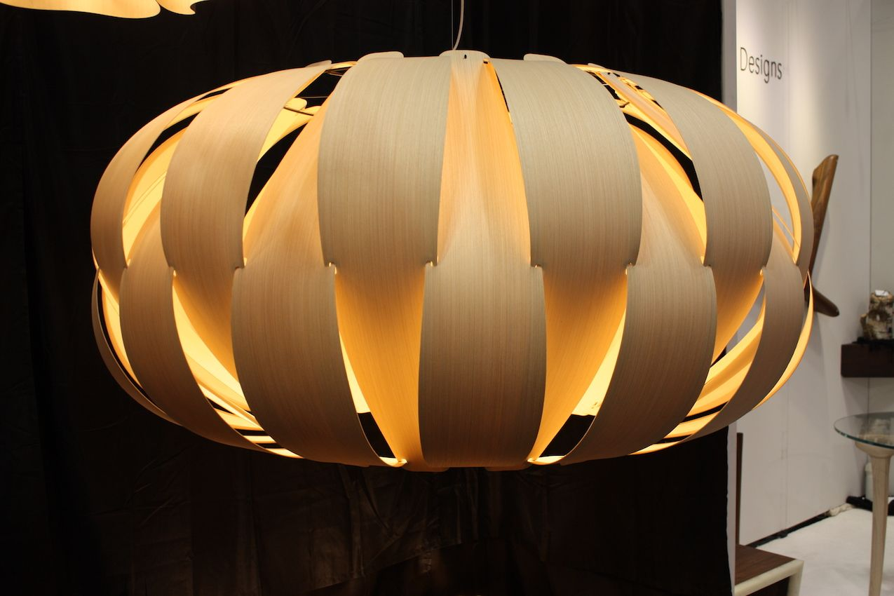 This pendant has a lantern shape paired with Scandinavian construction.