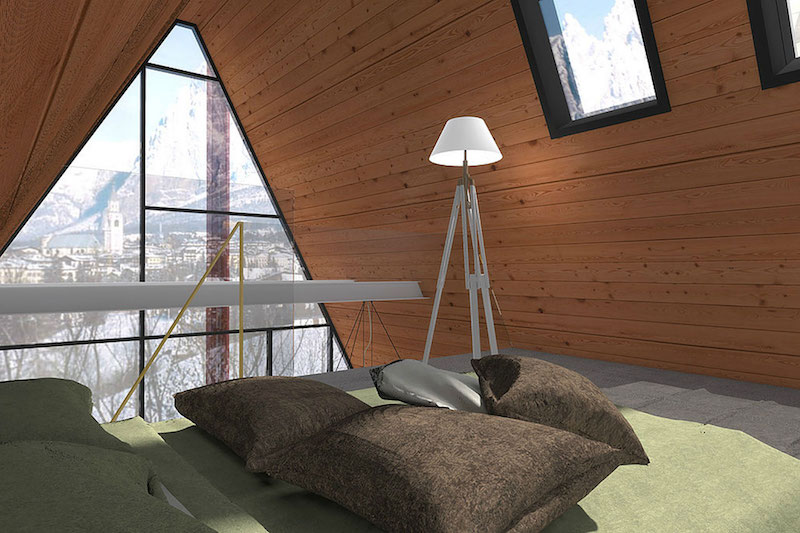 The loft area is where the sleeping space is situated. It's cozy and small, like an attic