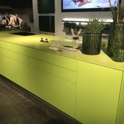 Modern kitchen with a green lime kitchen island
