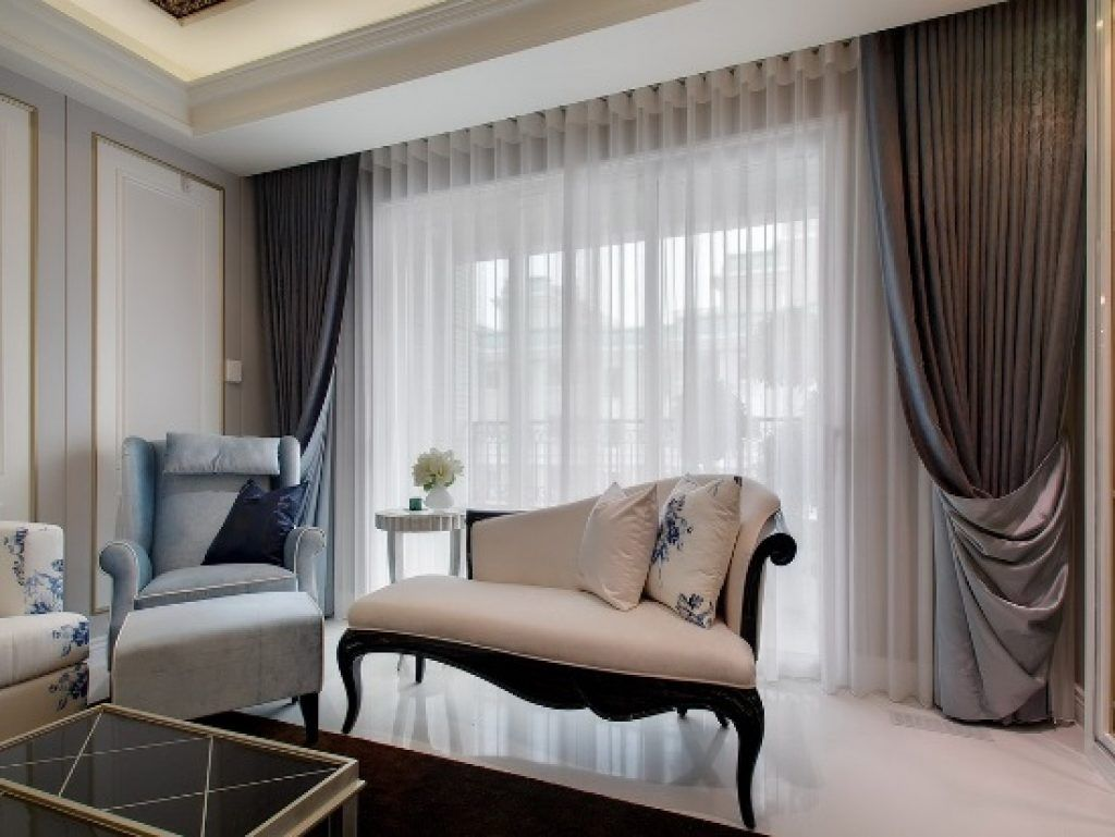 Combining types of curtains is a common decorating strategy.