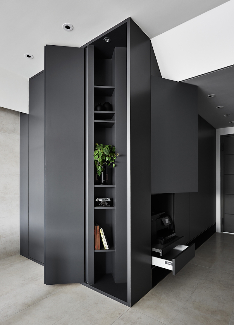 This large unit at the entryway provide ample storage and display spaces and also serves as a focal point