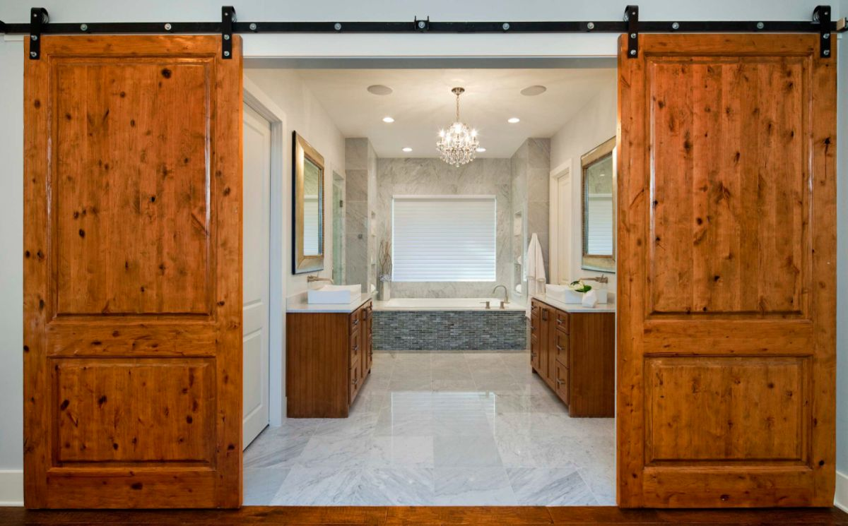 How To Make The Most Of A Barn Door In A Bedroom-Bathroom Scenario Sliding Door For Bathroom on accordion door for bathroom, aluminum door for bathroom, exterior door for bathroom, aluminium doors for bathroom, roll up door for bathroom, double door for bathroom, pocket door for bathroom, pantry for bathroom, interior sliding barn door bathroom, folding door for bathroom, sliding bathroom doors design, rustic barn door bathroom, solar tube for bathroom, french doors for bathroom, slide doors for bathroom, indoor jacuzzi for bathroom, industrial design house bathroom, bifold door for bathroom, back door for bathroom, swinging door for bathroom,