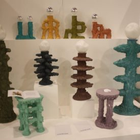 A little stumpy and very earthy feeling, the lights and occasional tables are colorful and funky.