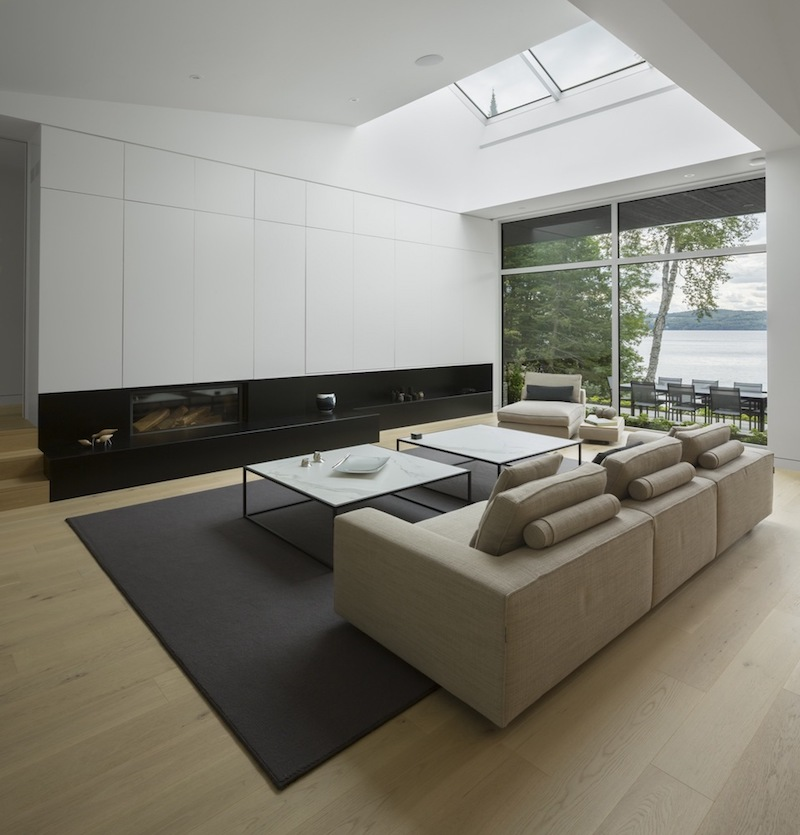 The interior of the house is full of natural light which comes through the large windows and the skylights