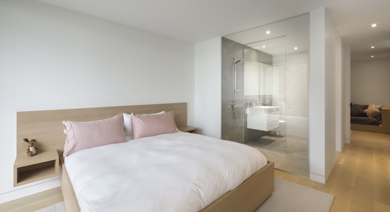 The bedroom suites are just as bright and open and the common areas, featuring white walls and cozy wooden flooring