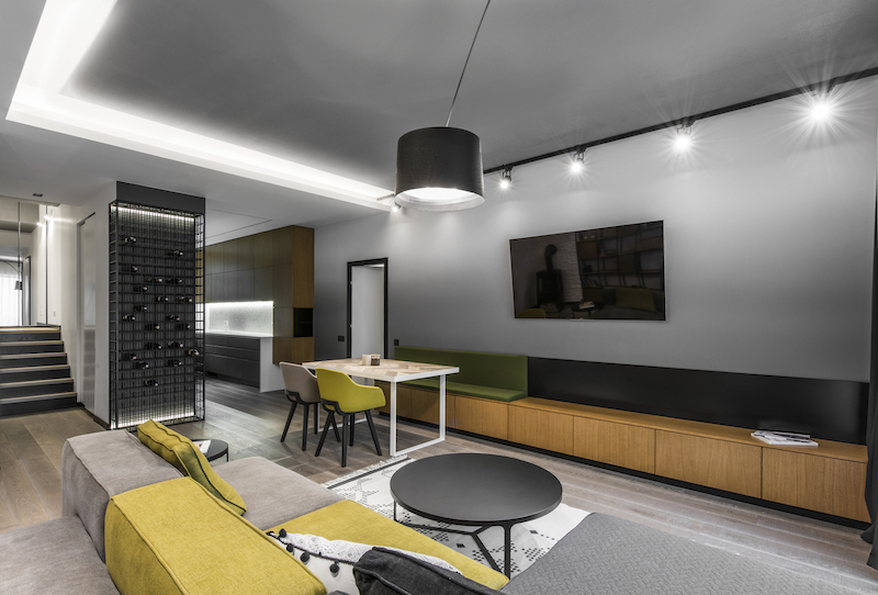 The apartment is structured into two volumes on two floors and this is the social area