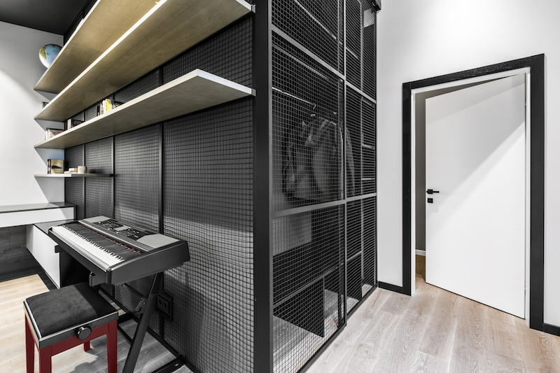 The apartment has an office room which features this cool metal mesh cabinet
