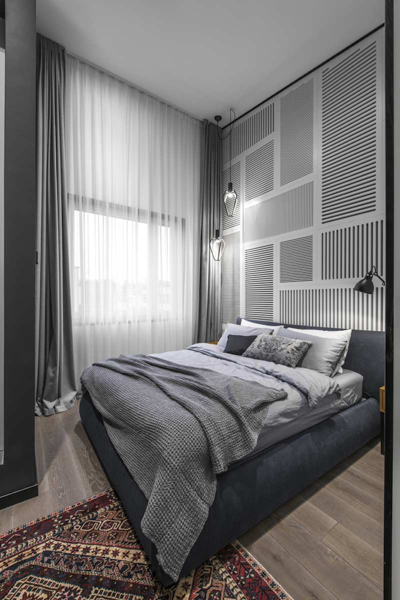 The bedroom is small, with barely enough room for the bare essentials. Still, it's airy