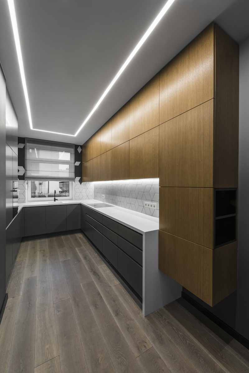 The kitchen is long and narrow which is not the most practical layout and yet it looks spacious