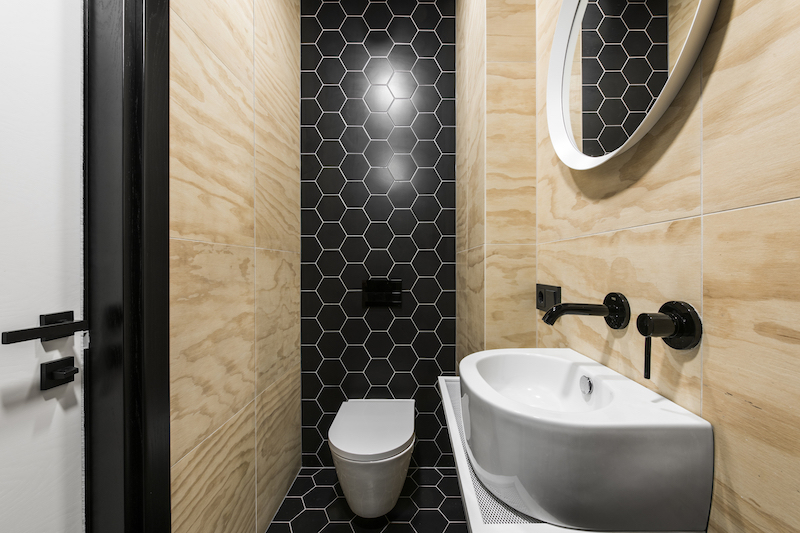 One of the bathrooms is small and has these chic hexagon-shaped tiles on its wall and floor