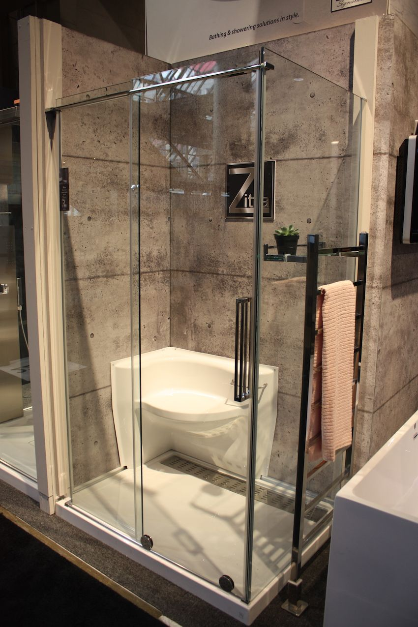 The corner shower also features a seat and long drain.