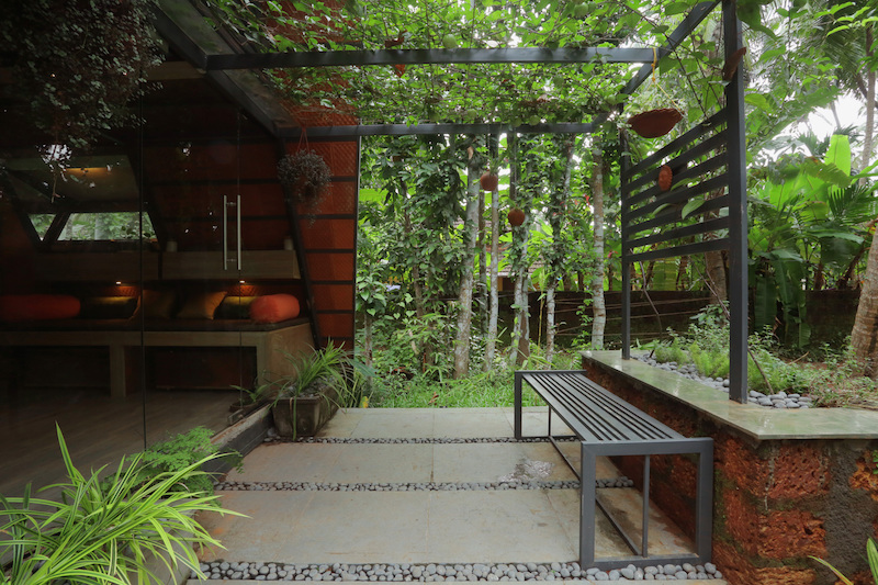 At the back, the interior space extends outside through a small deck with a lovely pergola
