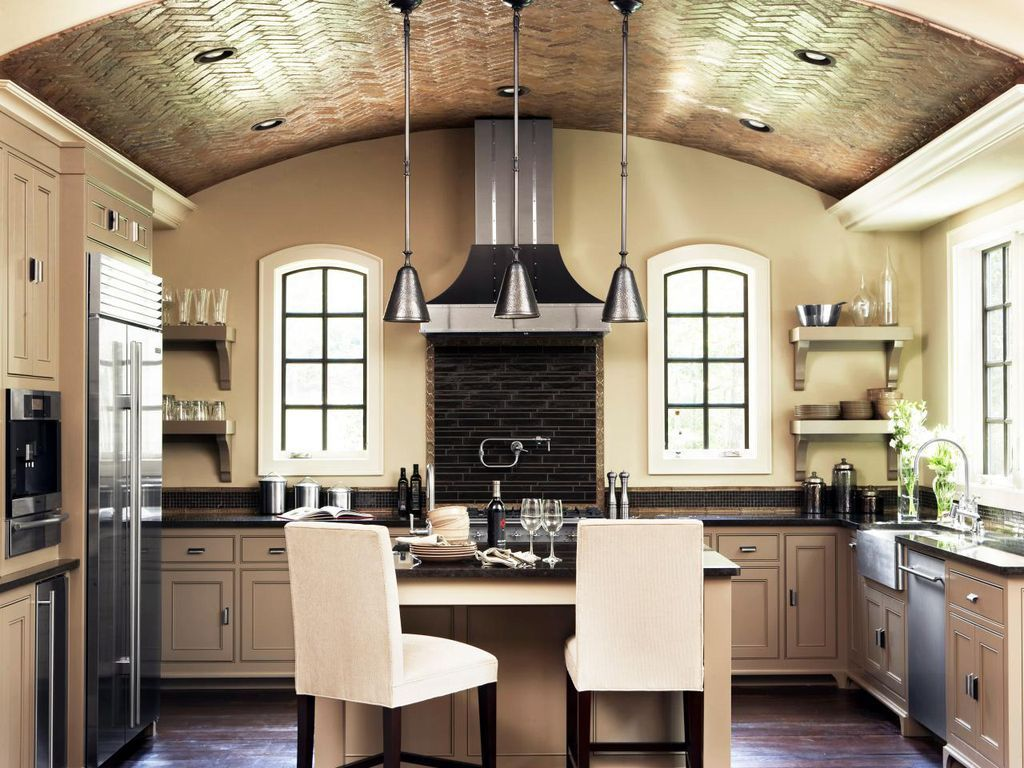 This kitchen combines a barrel vault with a tray ceiling for extra drama.