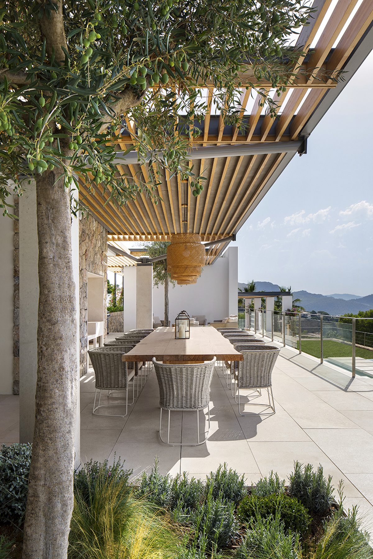 A beautiful wooden pergolas shades the al-fresco dining area which enjoys a panoramic view over the landscape