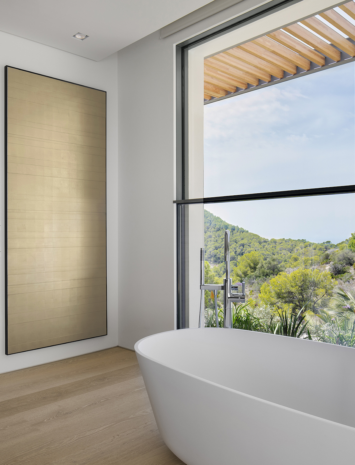 The master bathroom offers a very beautiful view of the valley and welcomes the fresh colors into its spa-inspired decor