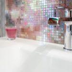 Colorful mosaic bathroom vanity backsplash