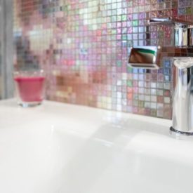 Colorful mosaic bathroom vanity backsplash