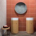 Cork vanity and oragen red backsplash tiles