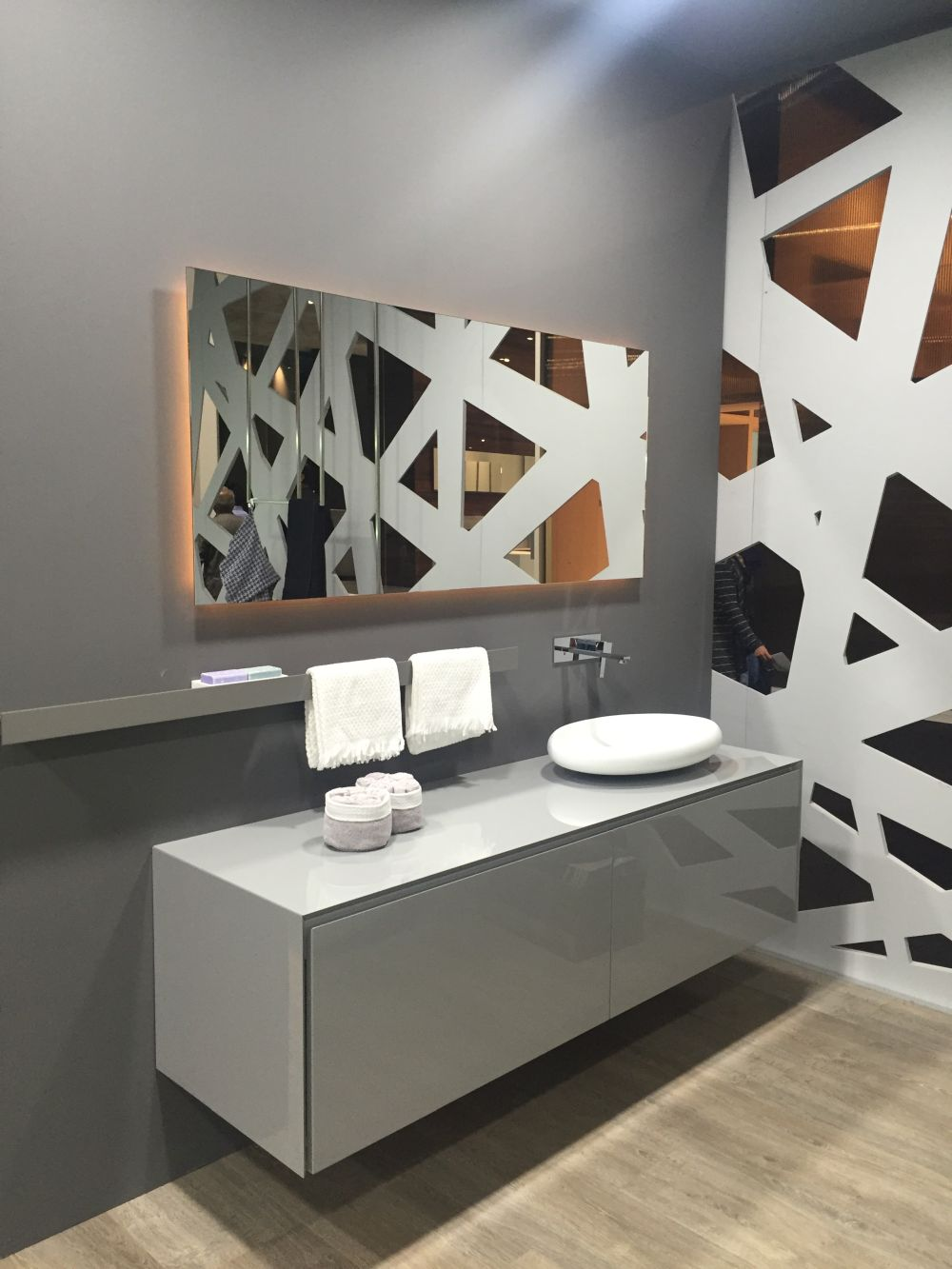 Use mirrors to add depth and glamour to the bathroom. You could use mirrors as cabinet fronts to save space