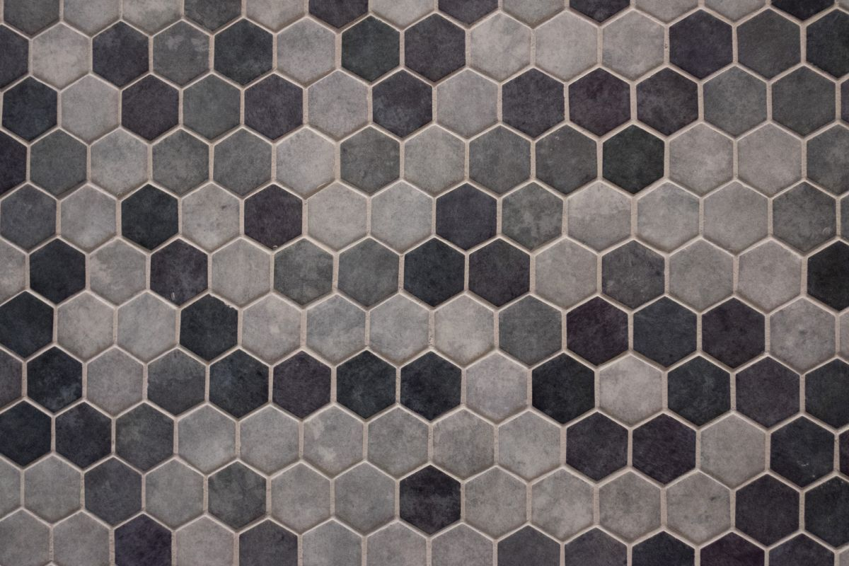 Hexagon-shaped tiles are very cute. You can use them to create a honeycomb-pattern for your bathroom backsplash