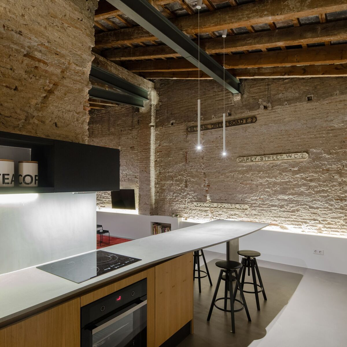 The texture of the exposed brick walls is beautifully highlighted by the accent lighting