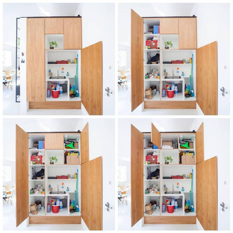 The pantry cabinet is well-organized and has multiple doors that open individually