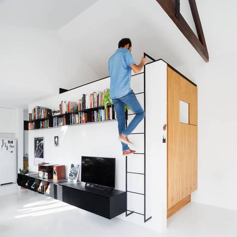 A metal ladder offers access to a secret space tucked beneath the ceiling