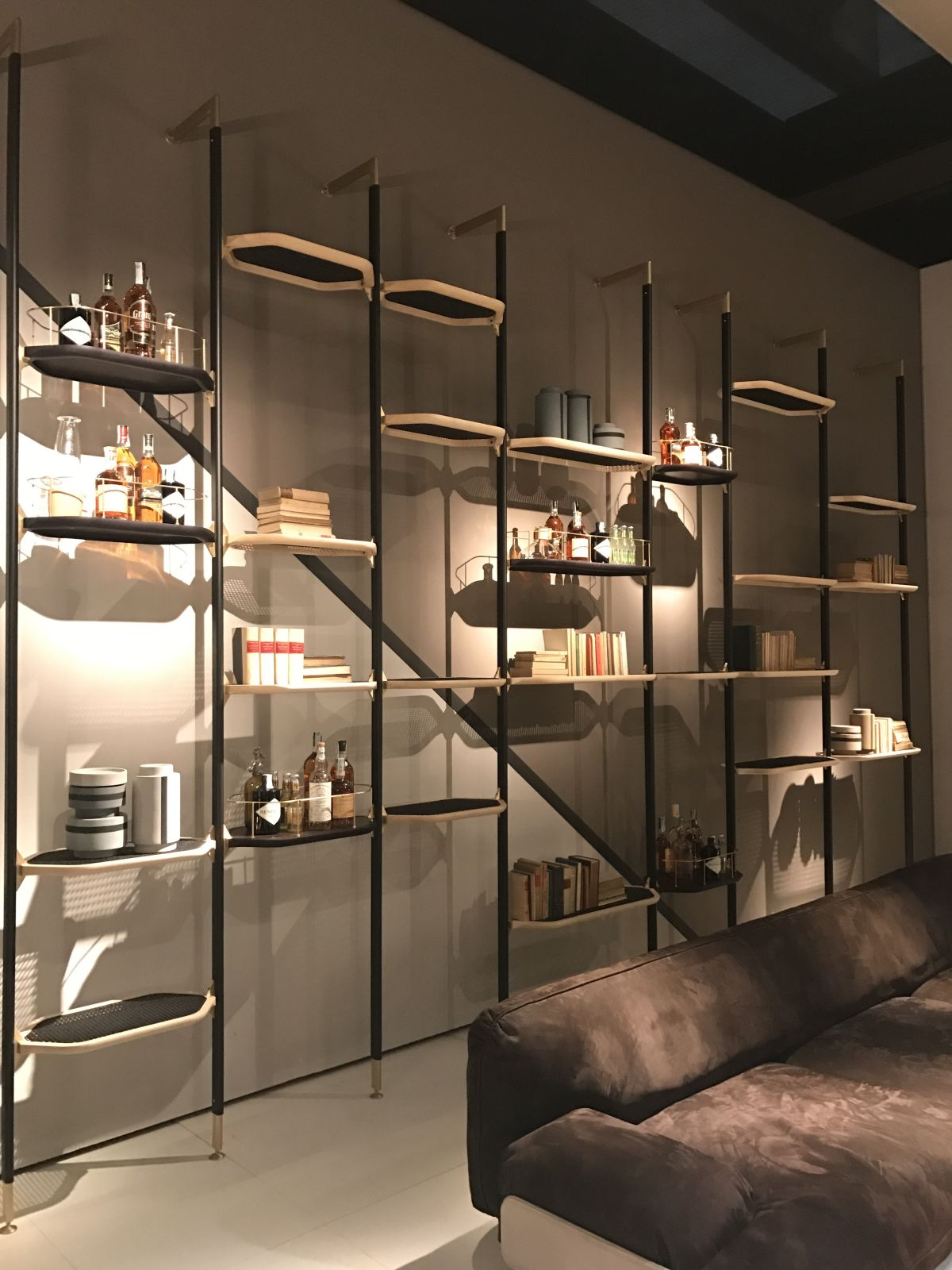 Display multiple shelves at various different heights to create a unique and asymmetrical installation