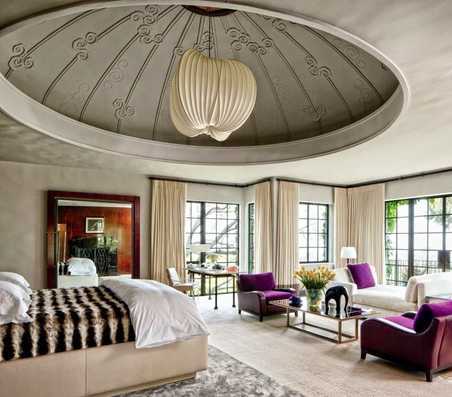 The dome in this bedroom adds drama to an already luxurious space.