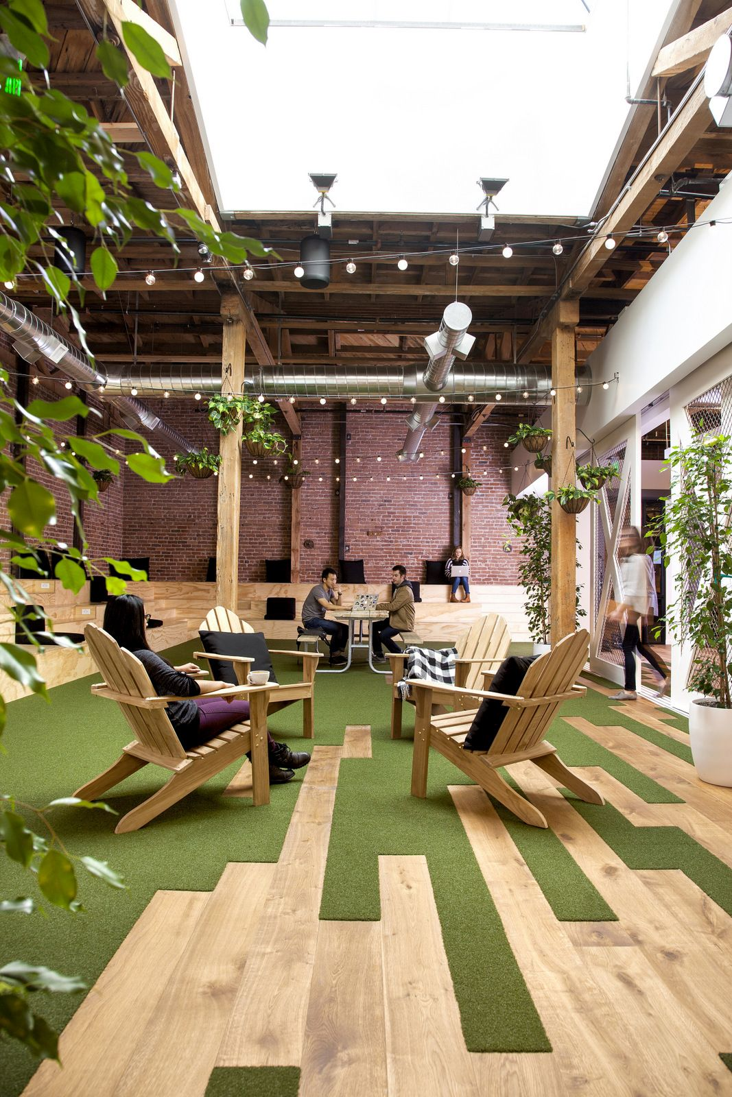 There's a space for everyone, including a green area with plants and an open ceiling