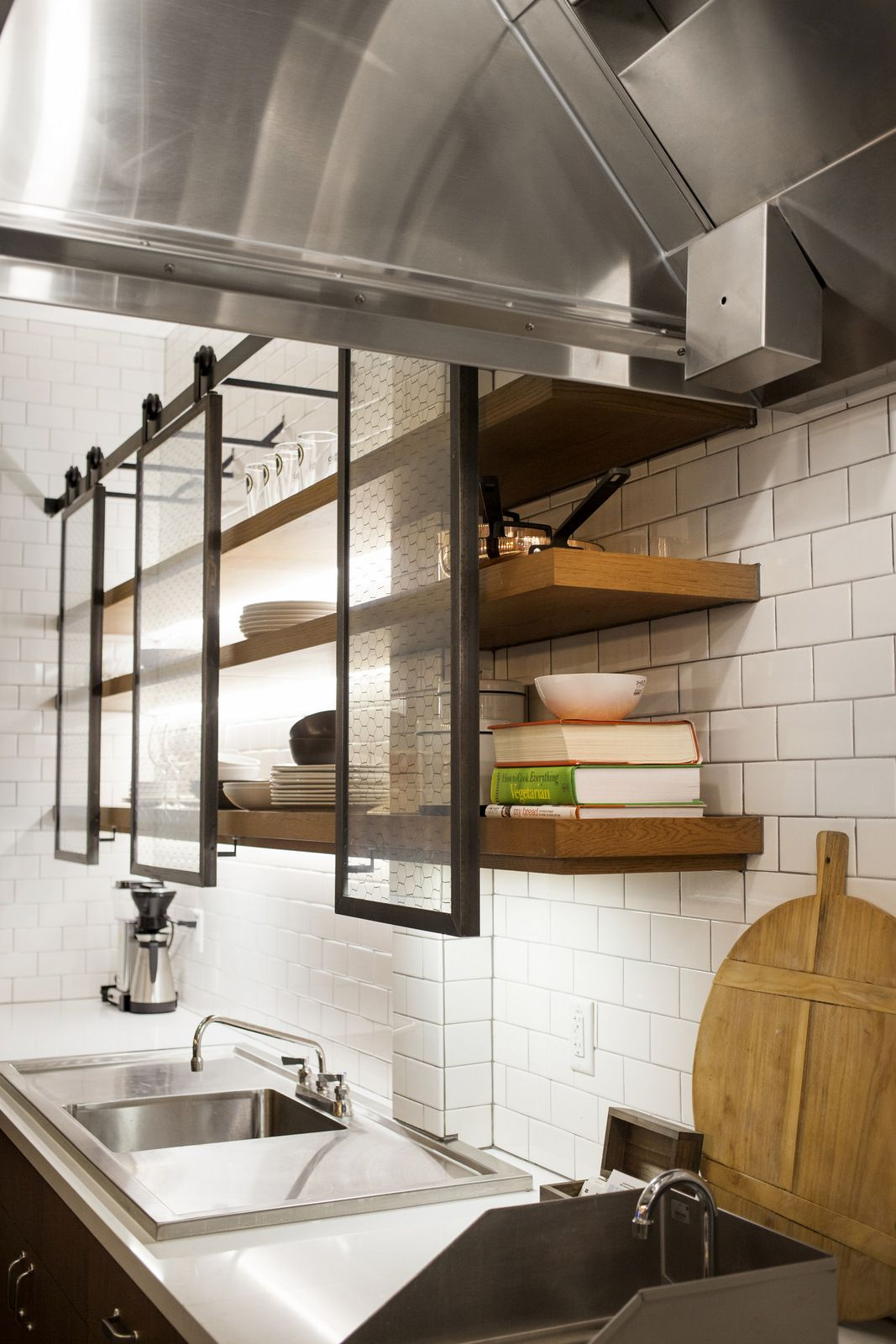 This stylish kitchen also features these really cool open shelves and a set of metal and glass frames