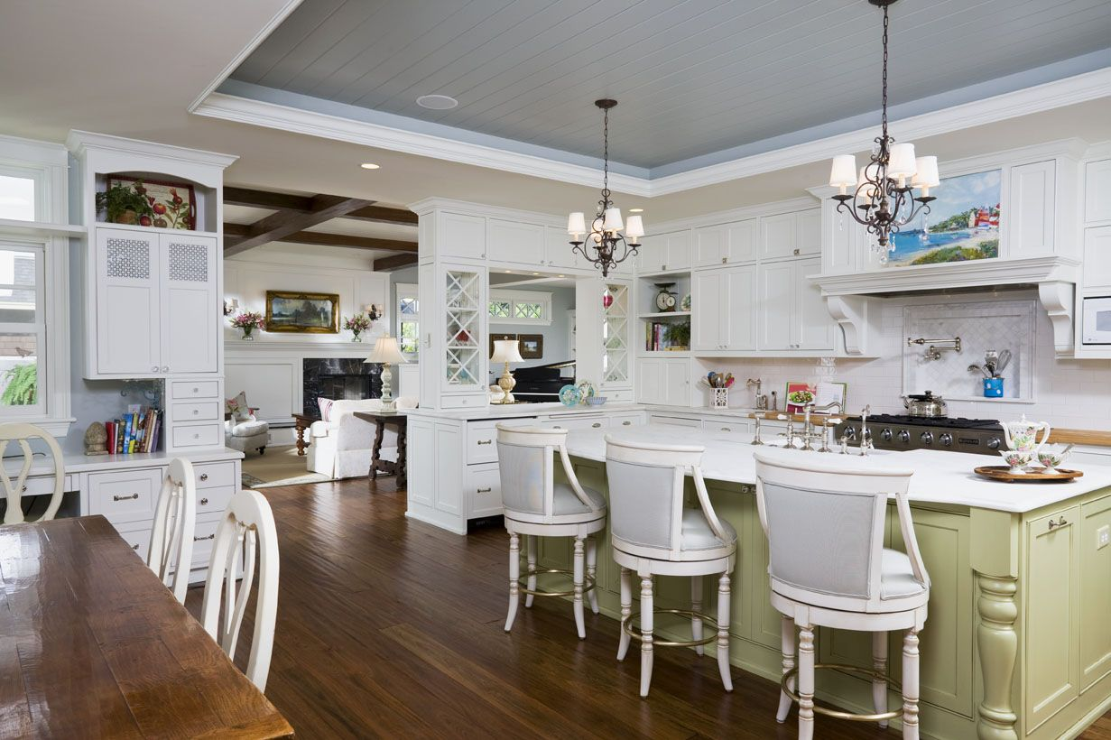 Wood panels in a neutral gray accent the tray ceiling in this kitchen.