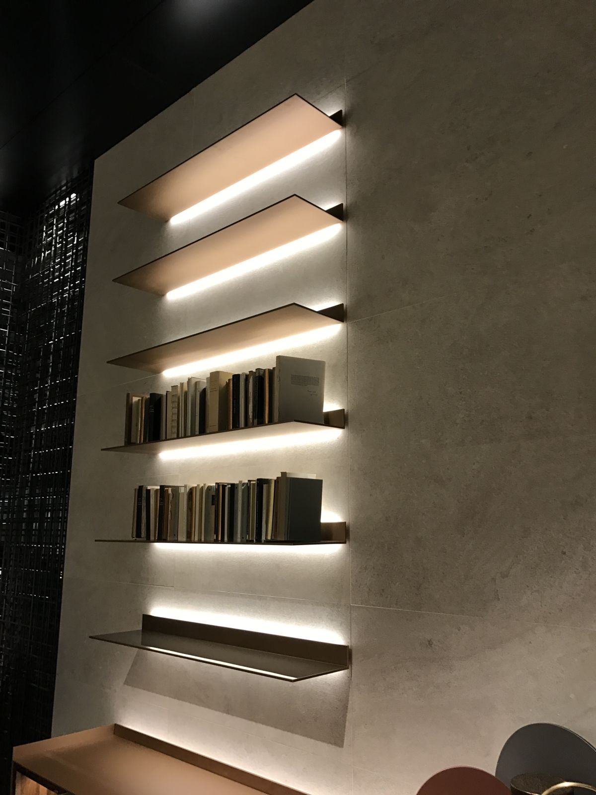 LED light strips are very effective at making wall shelves and their contents stand out in a dramatic way