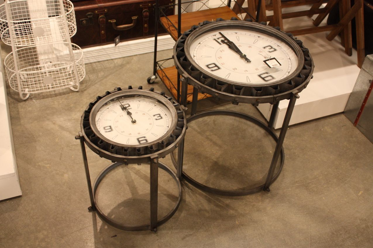 These accent table combine gears, vintage clock faces and plenty of metal.